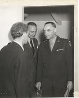 Photograph of unidentified officer with two civilians