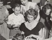Photo of Rita Hayworth giving autographs