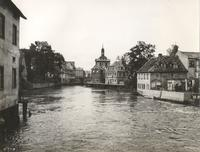 Photo of river running through village