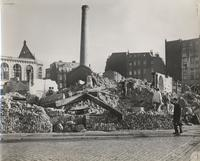 Photo of rubble surrounded by four buildings that are (more or less) intact (duplicate of ntp037.tif)