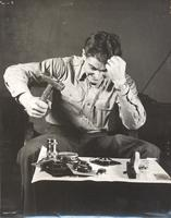 Photo of man preparing to smash camera components with mallet