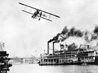 Beachy-Curtis Biplane Over the Mississippi River