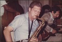 Zoot Sims closes his eyes as he plays the saxophone