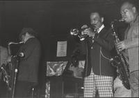 Zoot Sims, Buck Clayton and Budd Johnson play from the stage