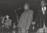 Zoot Sims, Budd Johnson, and Buck Clayton wait for, possibly Nancy Harrow, to sing her solo