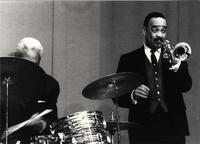Buck Clayton on stage with his trumpet
