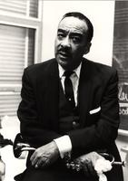 Buck Clayton with his trumpet backstage
