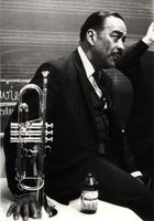 Buck Clayton backstage with a beer