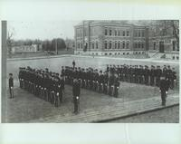 Cadets in formation in front of Mechanical Arts Building