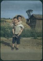 Hiller 09-029: Two children, one riding piggyback 1