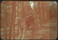 Hiller 09-056 : A woman sitting on a stone horse in Nanking