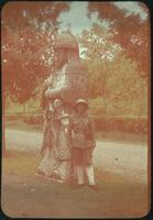 Hiller 09-057 : A man with statue of a guard on the Spirit Way