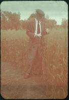 Hiller 09-075: A man standing in front of crop field in Nanking