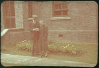 Hiller 09-083: A couple standing in front of a brick house in Nanking 1