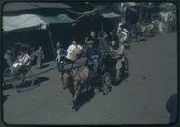 Hiller 09-106 : People driving horse carts and pulling rickshaws on the street 1