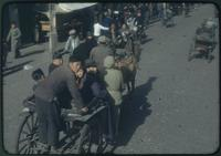 Hiller 09-107 : People driving horse carts and pulling rickshaws on a street 2