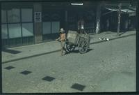 Hiller 09-109 : Pulled rickshaw by man on a street