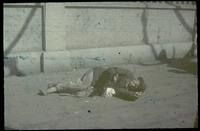 Hiller 04-003 e: A man, lying on the ground, begging, number 1