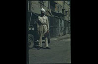 Hiller 04-people-02: A man with a turban, posing in front of a vehicle