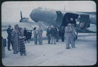 Hiller 08-01: Military personnel standing next to a grounded plane, Peiping