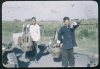 Hiller 08-009a: Two men with carrying poles, Peiping