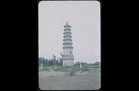 Hiller 08-098: Ornate, tiered structure in a dirt field, Peiping