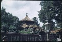 Hiller 08-103: Ribbed pagoda roof behind a fence, Peiping