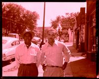 Two unidentified African-American men posing on a sidewalk