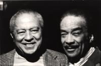 Dicky Wells and Buck Clayton smile