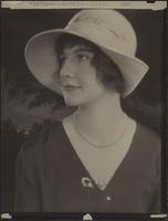 Unidentified woman in white hat