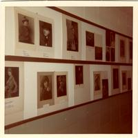 Group of portraits on the wall at the Winona School of Professional Photography