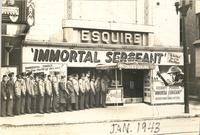 "Group of soldiers lined up to see ""Immortal Sergeant"" outside the Esquire Theatre"