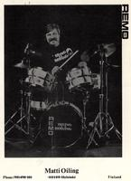 Postcard with Matti Oiling playing drums