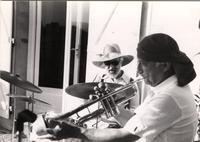 Jean-Marie Masse playing drums with trumpet player