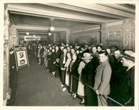 "Crowd lined up to see the film ""One Night of Love"" in the lobby of  Tower Theatre"