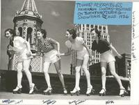 Tower Adorables on roller skates on the roof of Tower Theatre