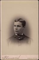 Young man wearing a coat with a bow tie
