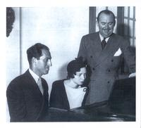 Dana Suesse seated at a piano with George Gershwin and Paul Whiteman