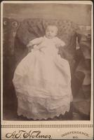 Infant in long christening gown