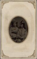 Two seated young women
