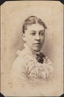 Woman in ornate dress with high lace collar