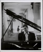 Publicity photo of Peter Duchin playing the piano