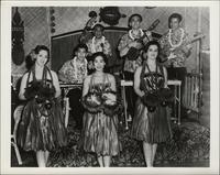 Seven unidentified Polynesian dancers and musicians