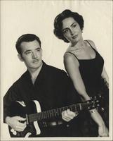 Unidentified man and woman posing with guitar