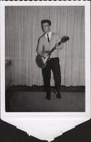 Publicity photo of unidentified man playing electric guitar