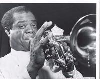 Publicity photo of Louis Armstrong playing trumpet