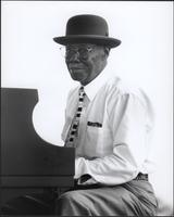 Pinetop Perkins at the Kansas City Blues & Jazz Fest smiles at the photographer