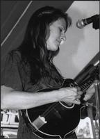 Karla Peterie playing a mandolin