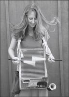 Karla Peterie playing a washboard