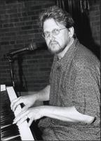 Mike Roark plays a piano
